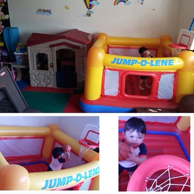 Gavin is enjoying his new toy in the playroom