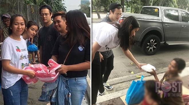 Image result for Liza Soberano and Enrique Gil handed food to less fortunates