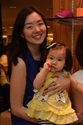 Basketball player Chris Tiu's wife Clarisse with their daughter