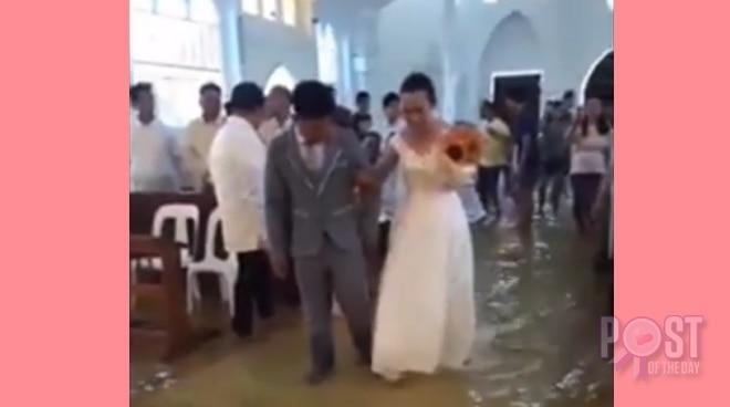 WATCH: Couple pushes through with wedding despite flood