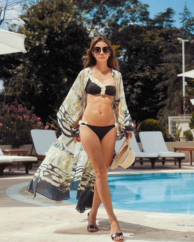 Marie Lozano shows off her toned tummy while vacationing in Turkey.