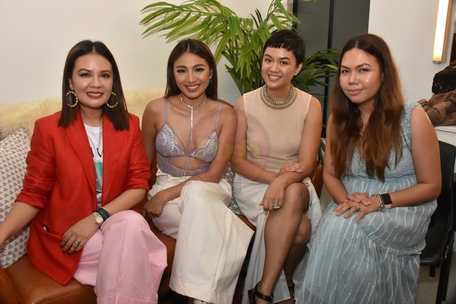 Nadine launches makeup line Lustrous with BYS at beauty convention.