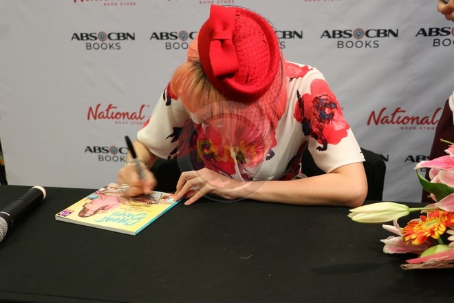 Fans came to meet Arci and buy her new book called Cheat Days.
