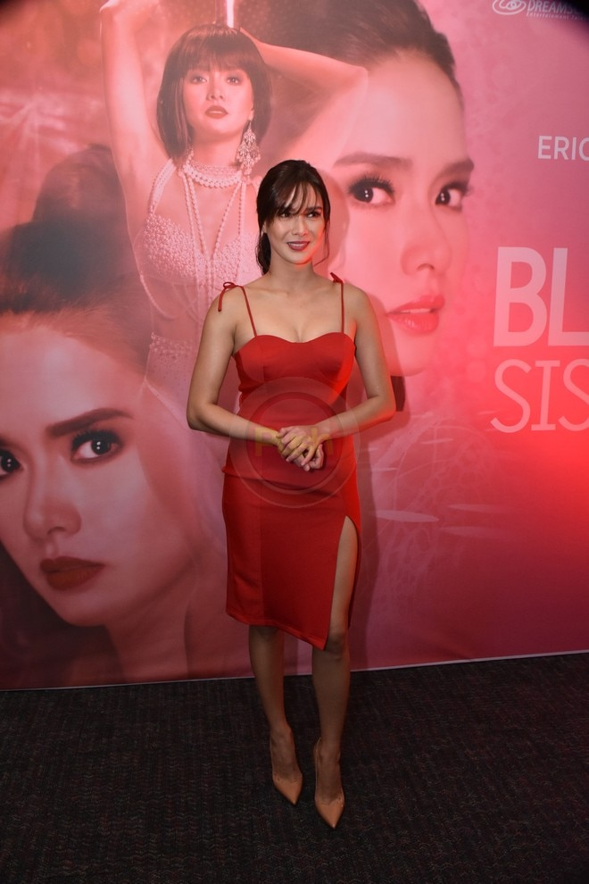 Erich looks sultry and lovely in red as she attends her soap The Blood Sisters' media conference.