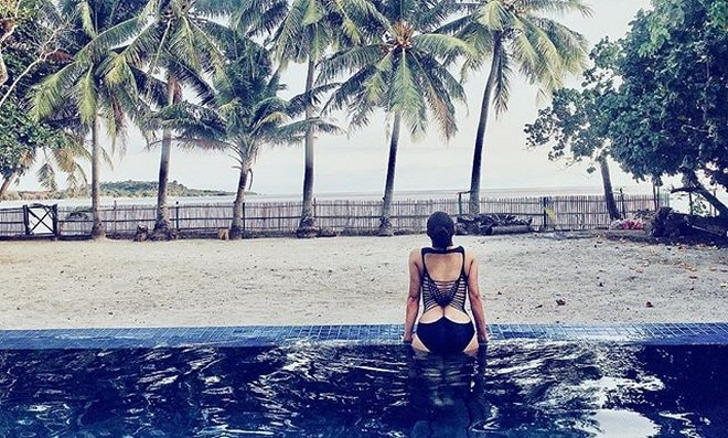Ryza Cenon shows off her swimsuit's intricate back.