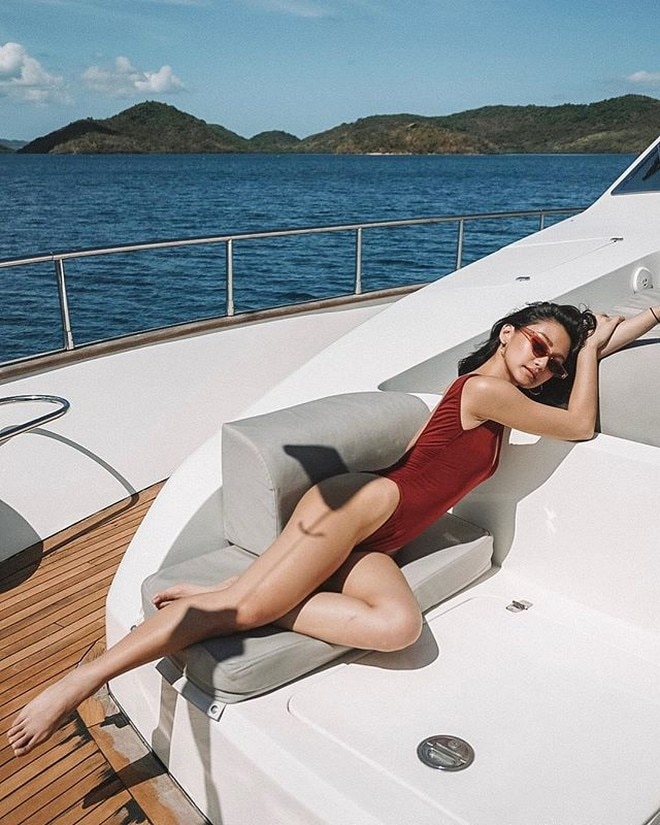 Chienna Filomeno enjoys the sun and the view of the sea.