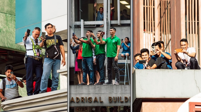 LOOK: Pinoys spotted taking 'buwis buhay' shots during Catriona Gray's homecoming parade