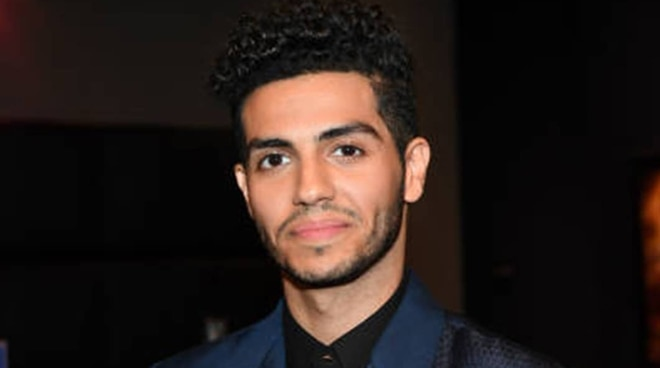 Aladdin star Mena Massoud wears a Pinoy designer suit during the movie's Canadian premiere