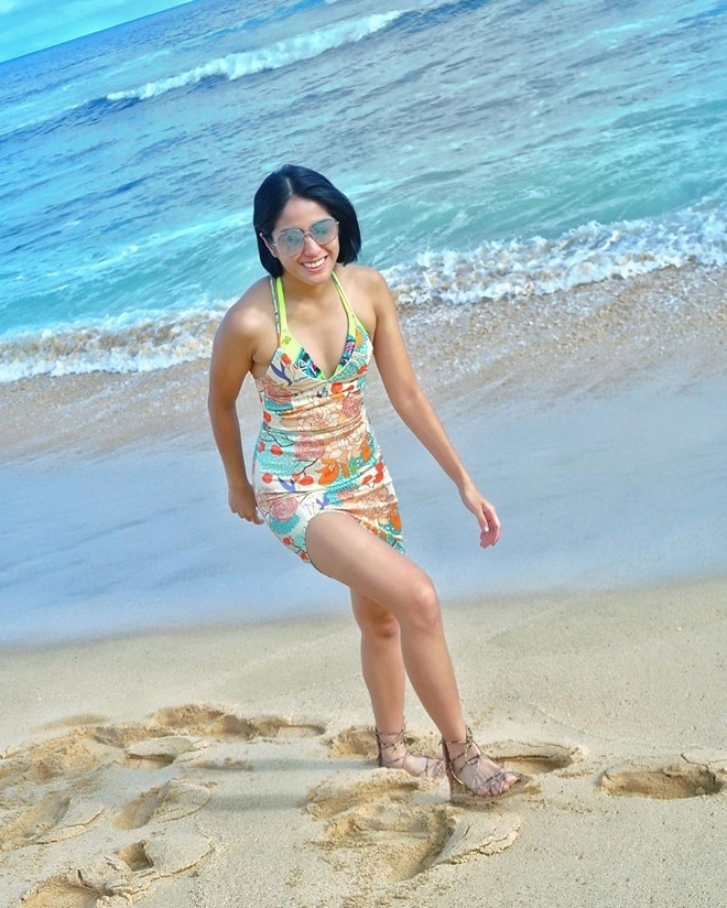 TV reporter Gretchen Go enjoys an endless summer on the tropical beaches of Hawaii